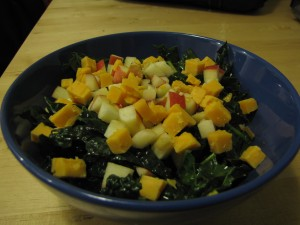 kale salad with diced apple and extra sharp cheddar